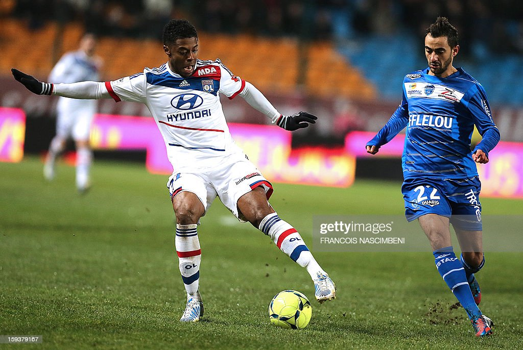Troyes' midfielder Fabien Camus (R) vies with Lyon's midfielder Bastos (L) during a French L1 football match between Troyes and Lyon on January 12, 2013 at the Aube Stadium in Troyes.