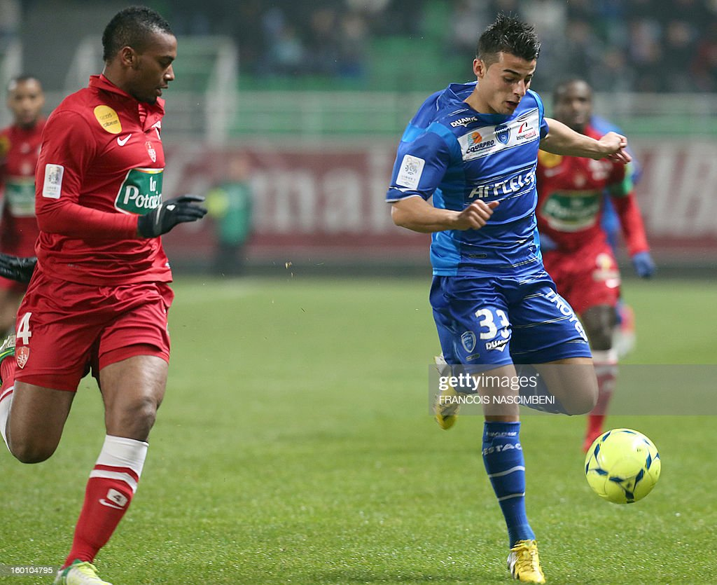 Troyes' midfielder Jean Corentin (R) vies with Brest's French defender Johan Martial (L) during the French L1 football match Troyes vs Brest on January 26, 2013 at the Aube stadium in Troyes. PHOTO