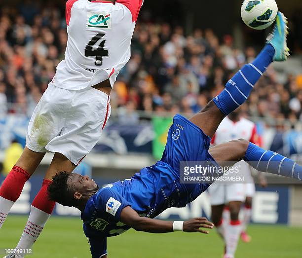 Troyes' midfielder JeanChristophe kicks the ball on April 16 2013 during the French Cup quater final football match Troyes vs Nancy in the Aube...
