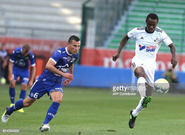 Troyes' midfielder Karim Azamoum vies for the ball against Amiens' defender Khaled Adenon during the friendly football match between Troyes and...