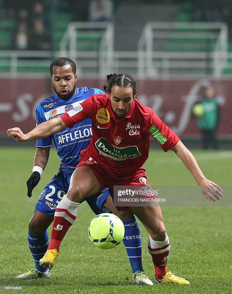 Troyes' midfielder Quentin Othon (L) vies with Brest's French midfielder Bruno Grougi (R) during the French L1 football match Troyes vs Brest on January 26, 2013 at the Aube stadium in Troyes. PHOTO