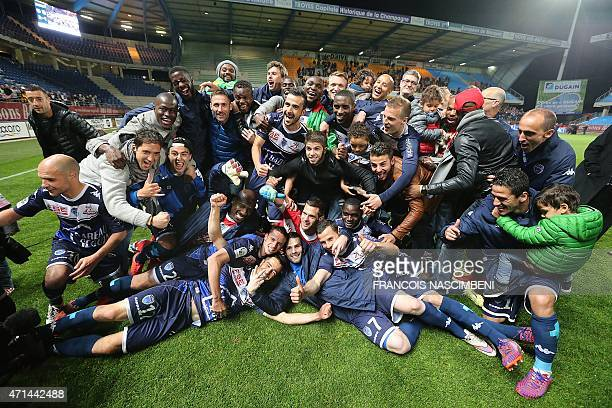 Troyes' players celebrate after winning the French L2 football match against Angers at the Aube Stadium in Troyes on April 28 2015 AFP PHOTO /...