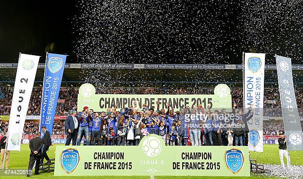 Troyes' players celebrate after winning the French Ligue 2 Football Championship after the French Football match between Troyes and Chateauroux on...