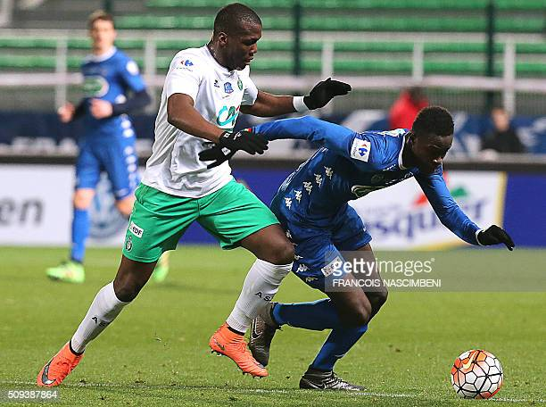 Troyes' Senegalese forward Babacar Gueye vies with SaintEtienne's Guinean defender Florentin Pogba during the French Cup football match between...