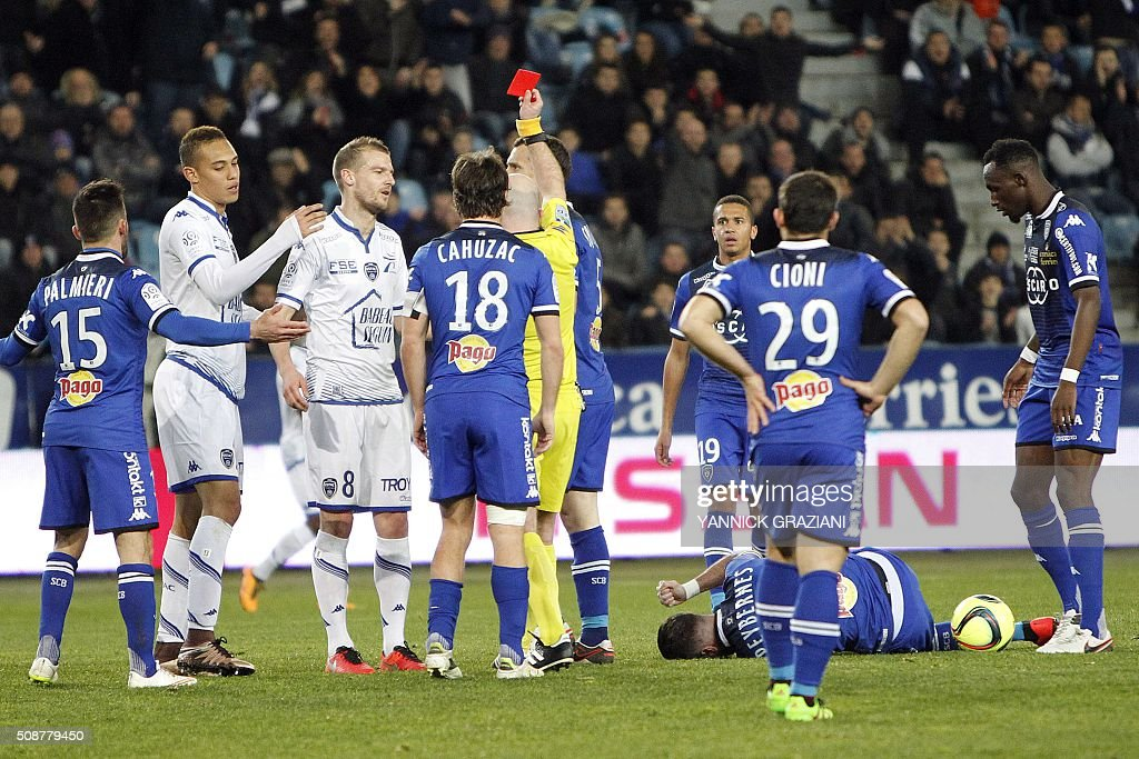 Troyes' Stephane Darbion (3rd L) react as he receives a red card during the French L1 football match between Bastia and Troyes on February 6, 2016 at Armand Cesari stadium in Furiani, near Bastia, on the French Mediterranean island of Corsica. AFP PHOTO / YANNICK GRAZIANI / AFP / YANNICK GRAZIANI