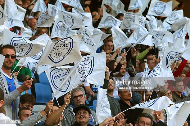 Troyes' supporters wave flags prior to the French Football match between Troyes and Chateauroux on May 22 2015 at the Aube Stadium in Troyes central...