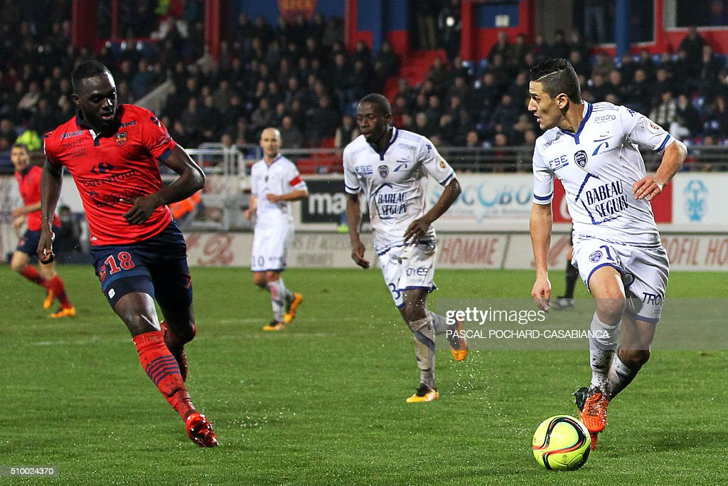 Troyes' Tunisian midfielder Chaouki Nen Saada (R) vies for the ball with Ajaccio's French midfielder Amos Youga during the French L1 football match between Gazelec Ajaccio (GFCA) and Troyes (ESTAC) on February 13, 2016, at the Ange Casanova stadium in Ajaccio, on the French Mediterranean island of Corsica. AFP PHOTO / PASCAL POCHARD-CASABIANCA / AFP / PASCAL POCHARD-CASABIANCA