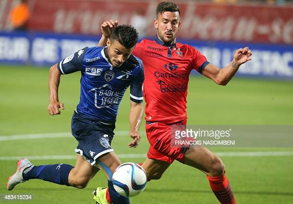 Troyes's french forward Corentin Jean vies with Ajaccio's defender Pablo Martinez during the French L1 football match between Troyes and Ajaccio at...
