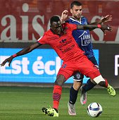 Troyes's French midfielder Yoann Court vies with Ajaccio's defender Issiaga Sylla during the French L1 football match between Troyes and Ajaccio at...