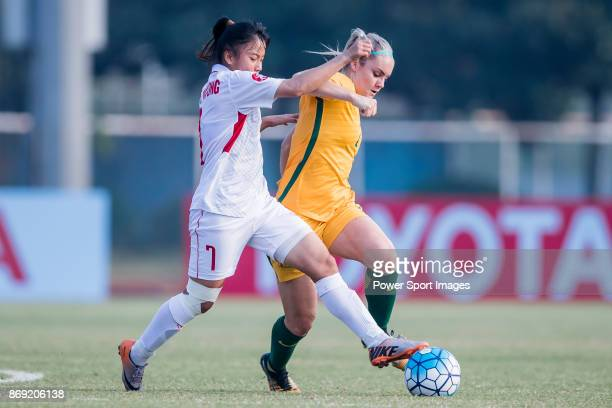 Truc Huong of Vietnam fights for the ball with Ellie Carpenter of Australia during their AFC U19 Women's Championship 2017 Group Stage match between...