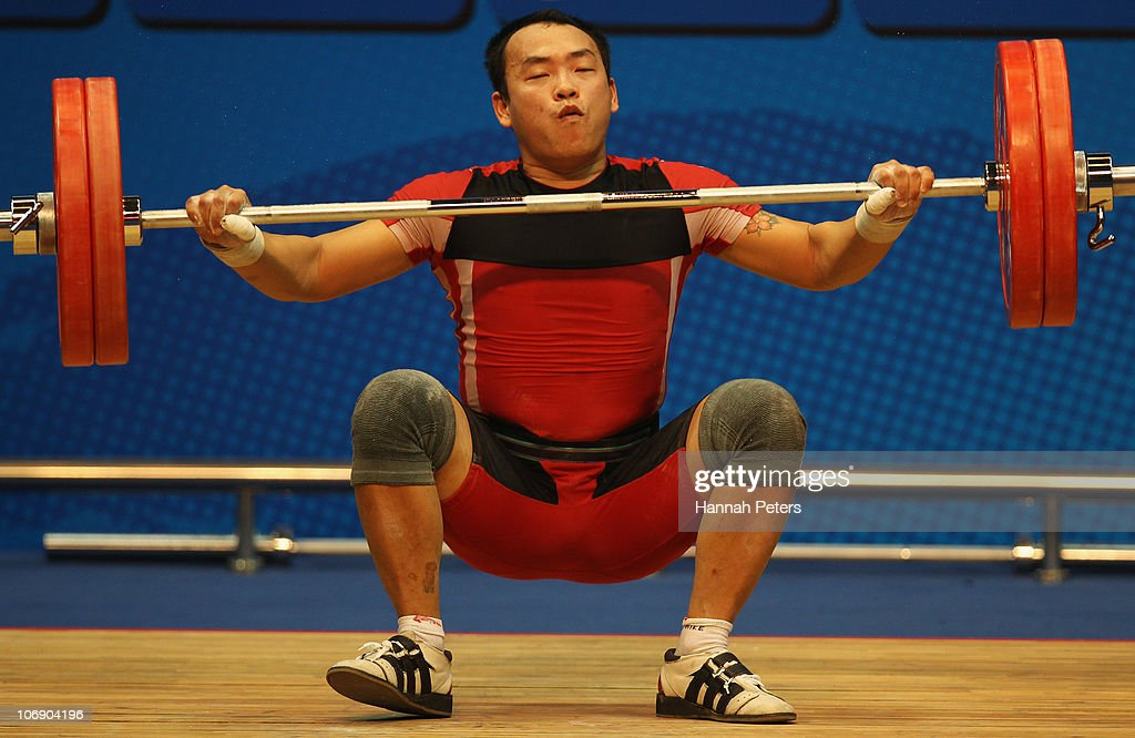 Truc Thanh Duong of Vietnam competes in the Men's Weightlifting 77kg competition during day four of the 16th Asian Games Guangzhou 2010 at Dongguan Gymnasium on November 16, 2010 in Guangzhou, China.