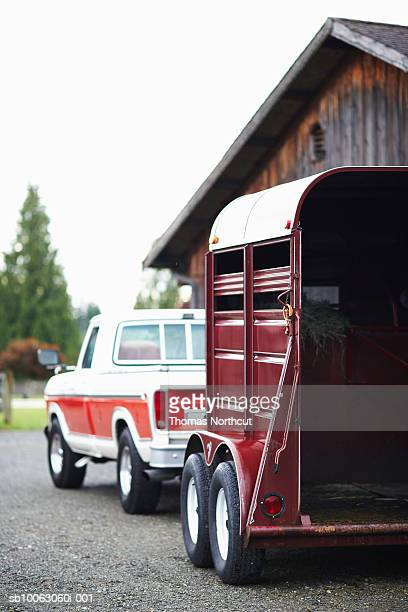 Truck and horse trailer parked at stables