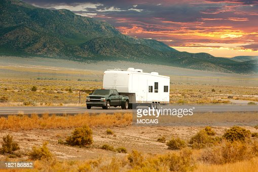 Truck and RV driving down road