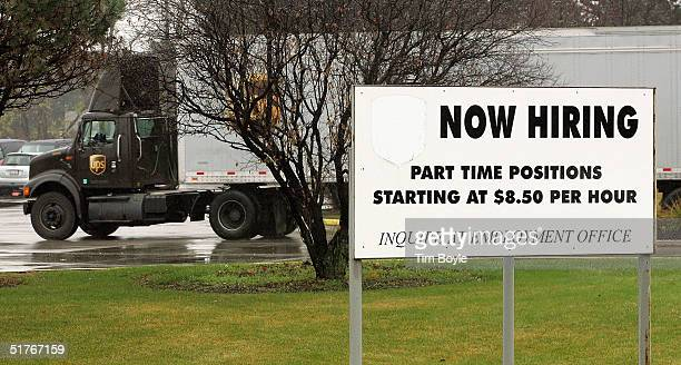 UPS truck arrives passes a hiring sign at a UPS package delivery facility November 19 2004 in Glenview Illinois UPS may be hiring upwards of 70000...