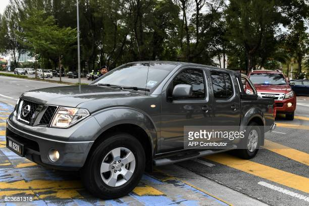 A truck believed to be carrying Vietnamese national Doan Thi Huong and Indonesian national Siti Aisyah arrive for their court appearance at the Shah...