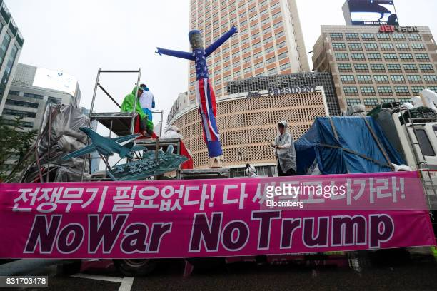 A truck carries a placard reading 'No War No Trump' following a rally against the deployment of the Terminal HighAltitude Area Defense system in...