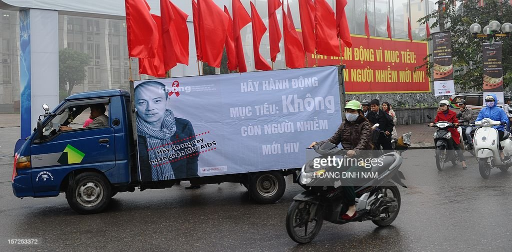 A truck carries a poster advertising World's AIDS Day in Hanoi on December 1, 2012. Since the first HIV case detected in 1990, the number of cases is projected to be 280,000 or 0.47 percent of the Vietnamese population in 2012 with injecting drug users (IDU) accounting for up to 65 percent of people living with HIV. AFP PHOTO / HOANG DINH Nam