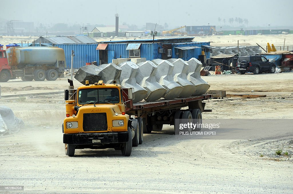 A truck carries accropode, a sea defence barrier designed and built to withstand the most severe tidal surges, on January 31, 2013 in Lagos, during the building of the three and a half kilometre long sea defence barrier called 'The Great Wall of Lagos' built to shield from coastal erosion Eko Atlantic, a new city born from the Altantic ocean in Lagos. Nigeria's President Goodluck Jonathan and former US President Bill Clinton dedicated on February 21, 2013 the new 5-million-square-metre Eko Atlantic City, which is to be the first modern smart city in Africa to be built on reclaimed land from the Atlantic Ocean.