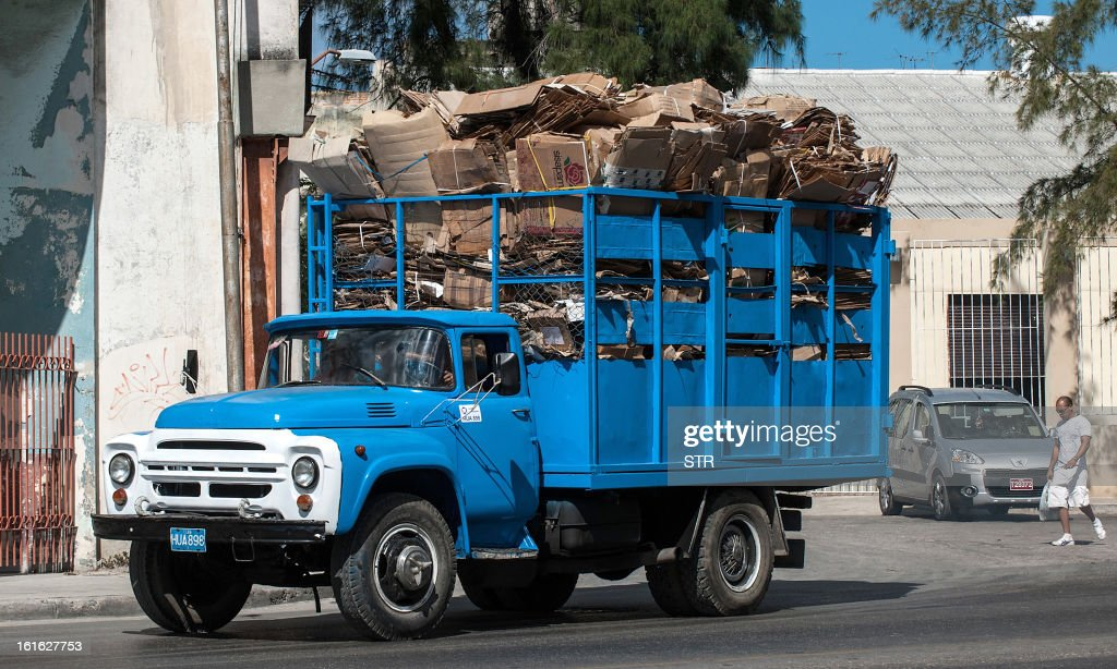 A truck carries cardboard boxes for recycling in Havana on February 13, 2013.