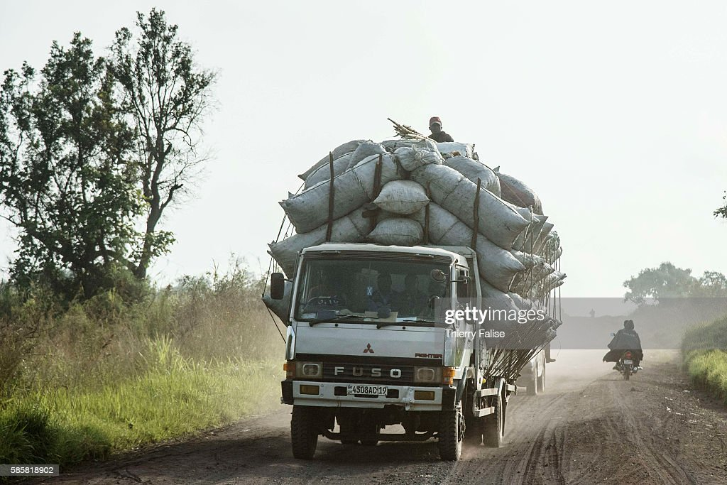 A truck carries charcoal produced from wood illegally cut from the slopes of Mount Nyiragongo The Nyiragongo is an active stratovolcano with an...