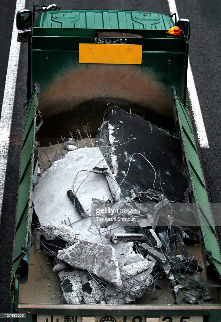 A truck carries concrete blocks from Sasago Tunnel of the Chuo expressway on December 3, 2012 in Otsuki, Yamanashi, Japan. The concrete ceiling panels of the tunnel collapsed 130 metres and 9 people confirmed dead.