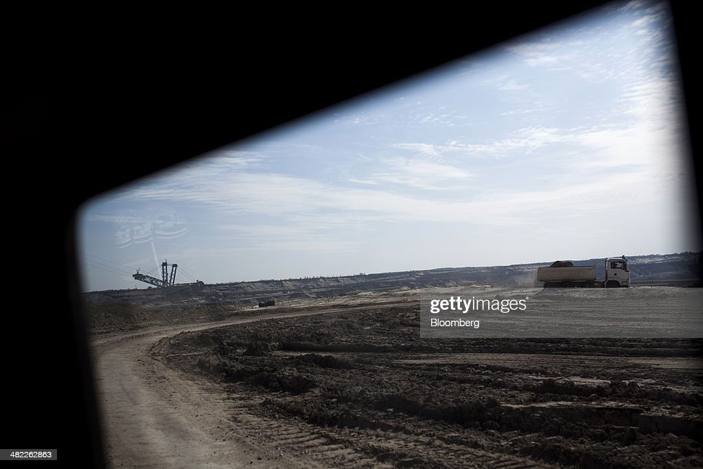 A truck carries lignite, also known as brown coal, from the pit floor during digging operations at the open pit mine operated by PGE Elektrownia Belchatow SA near Belchatow, Poland, on Wednesday, April 2, 2014. Polish power prices are set to stay above German contracts through 2015, reversing a historic discount, as the cost of keeping plants open in the eastern European nation is factored in, according to Vattenfall AB. Photographer: Bartek Sadowski/Bloomberg via Getty Images