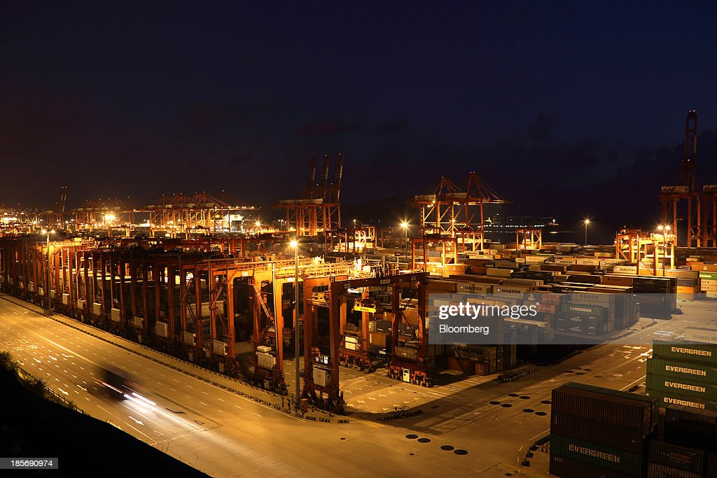 A truck carrying a shipping container drives through the Yangshan Deep Water Port, part of China (Shanghai) Pilot Free Trade Zone's Yangshan free trade port area, at night in Shanghai, China, on Wednesday, Oct. 23, 2013. The area is a testing ground for free-market policies that Premier Li Keqiang has signaled he may later implement more broadly in the world's second-largest economy. Photographer: Tomohiro Ohsumi/Bloomberg via Getty Images