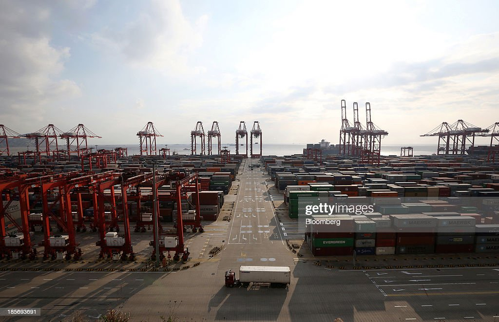 A truck carrying a shipping container drives through the Yangshan Deep Water Port, part of China (Shanghai) Pilot Free Trade Zone's Yangshan free trade port area, in Shanghai, China, on Wednesday, Oct. 23, 2013. The area is a testing ground for free-market policies that Premier Li Keqiang has signaled he may later implement more broadly in the world's second-largest economy. Photographer: Tomohiro Ohsumi/Bloomberg via Getty Images