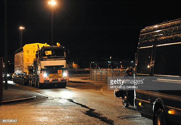 A truck carrying MOX fuel a blend of plutonium and reprocessed uranium is escorted by the police before its shipment to Japan on March 4 2009 near...
