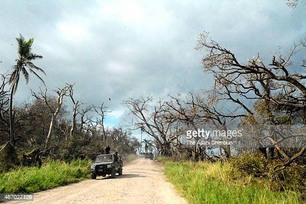 A truck carrying residents runs on a street on March 20 2015 in Tanna Vanuatu The Category 5 storm hit late night on March 13 causing widespread...