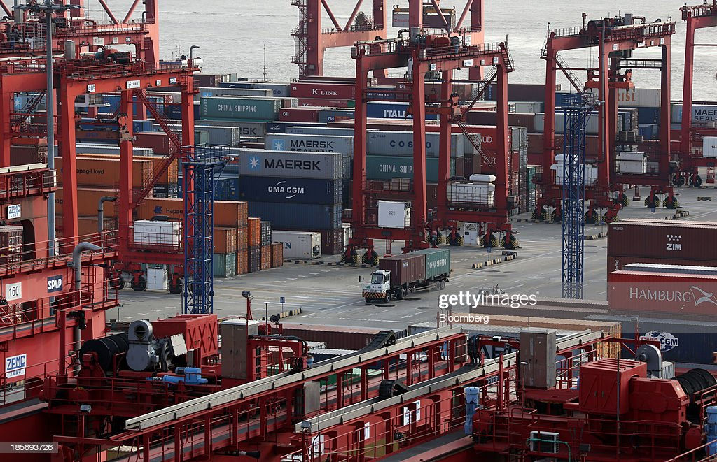 A truck carrying shipping containers drives through the Yangshan Deep Water Port, part of China (Shanghai) Pilot Free Trade Zone's Yangshan free trade port area, in Shanghai, China, on Wednesday, Oct. 23, 2013. The area is a testing ground for free-market policies that Premier Li Keqiang has signaled he may later implement more broadly in the world's second-largest economy. Photographer: Tomohiro Ohsumi/Bloomberg via Getty Images