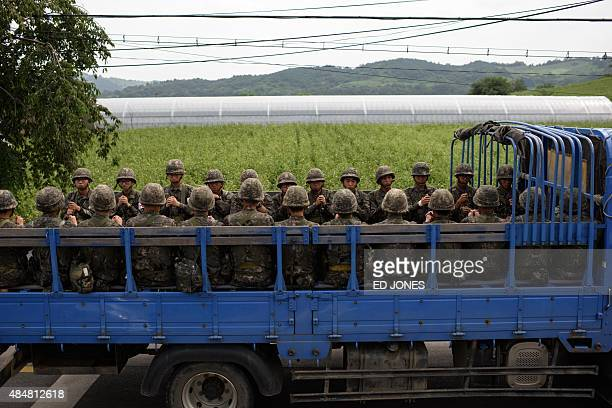 A truck carrying South Korean soldiers passes through the border village of Yeoncheon near the Demilitarized Zone on August 22 2015 South Korean...