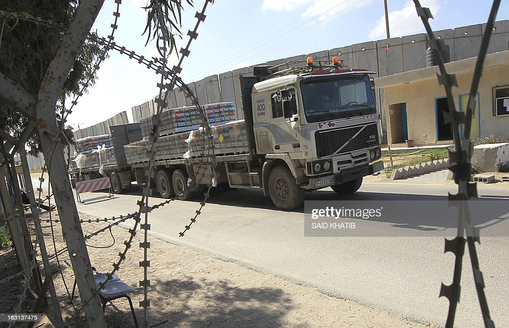 A truck carrying supplies cross into Rafah town through the Kerem Shalom crossing between Israel and the southern Gaza Strip on March 5, 2013. Israel reopened the Kerem Shalom commercial crossing into southern Gaza, six days after closing it after a rocket fired from the Palestinian enclave hit the Jewish state.