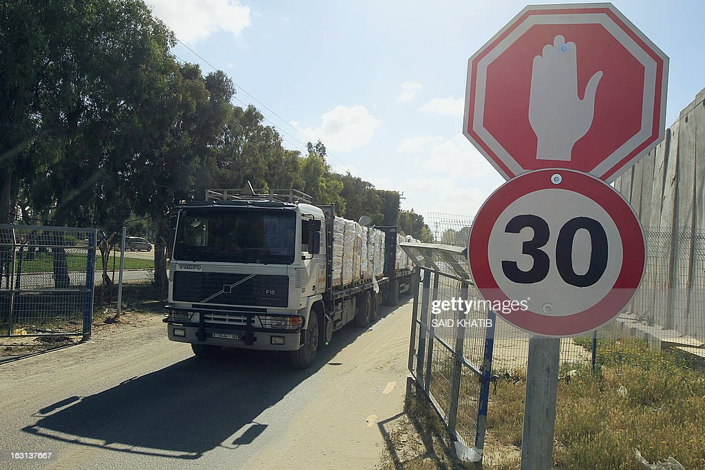 A truck carrying supplies crosses into Rafah town through the Kerem Shalom crossing between Israel and the southern Gaza Strip on March 5, 2013. Israel reopened the Kerem Shalom commercial crossing into southern Gaza, six days after closing it after a rocket fired from the Palestinian enclave hit the Jewish state. AFP PHOTO/SAID KHATIB