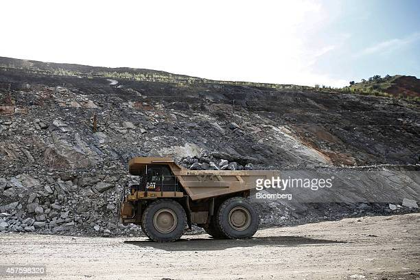 A truck collects a load of gold bearing rock ore collected from excavations in the open pit at the Kibali gold mine operated by Randgold Resources...