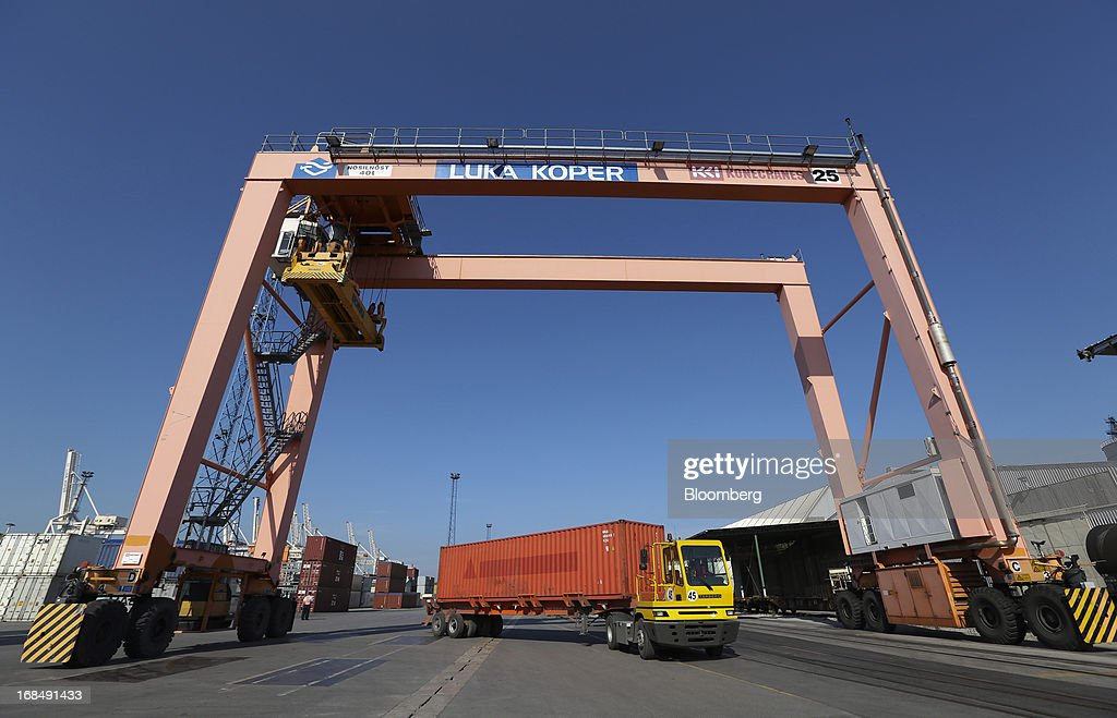 A truck collects a shipping container from the dockside at the port of Koper, operated by Luka Koper d.d., in Koper, Slovenia, on Thursday, May 9, 2013. The former Yugoslav nation, mired in its second recession since 2009, will contract this year and next, according to a May 3 report by the European Commission. Photographer: Chris Ratcliffe/Bloomberg via Getty Images