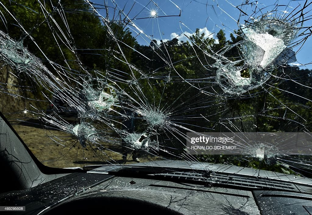 A truck damaged by gunfire is pictured at the El Aguila ranch in the municipality of Tamazula Durango State on October 18 2015 Dozens of bullets hit...