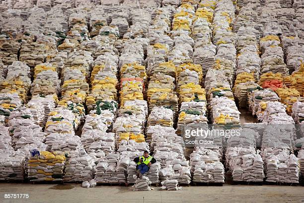 Truck driver Bryce Winjum relaxes on a pile of sandbags in the Fargodome April 1 2009 in Fargo North Dakota The city of Fargo has more than 300000...