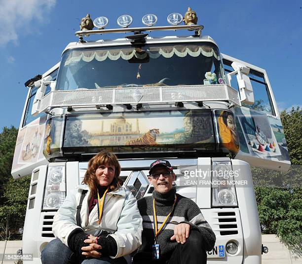 Truck driver Didier Vasseur and his wife Beatrice a painter inspired by Asian designs pose in front of their customized Renault Magnum 460 HP truck...