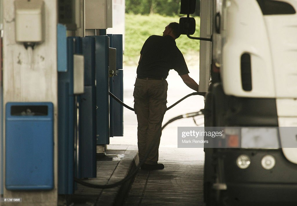 A truck driver fills the tank of his lorry with diesel at a fuel station on May 29 2008 in Luxembourg city Customers are driving up to 100 km from...