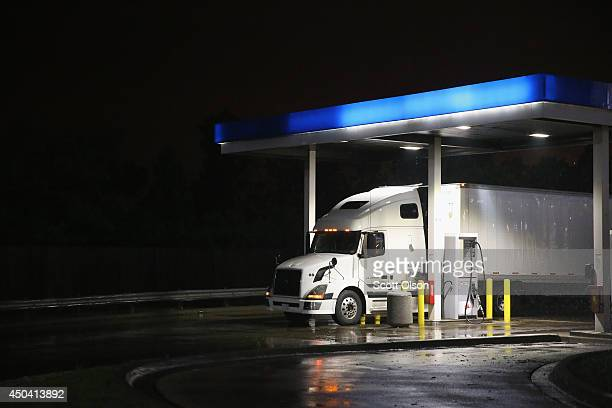A truck driver gets fuel on a rainy evening on the outskirts of Chicago on June 10 2014 in Hinsdale Illinois Legislation introduced in the US Senate...