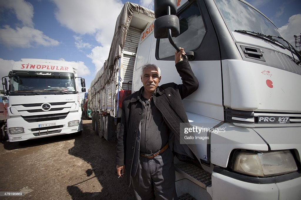 Truck driver Hamit Alay on March 12, 2014, in Killis City, Turkey. Alay has been at the Kilis border now for 10 days, waiting to go through to the Syrian side. He does this trip every 15 days and owns the truck. The load was fertilizer. Truck drivers at the Turkish/ Syrian border near Kilis City wait 10-15 days to get their good through to the customs area where Syrian truckers can take the load to Syrian towns. Since ISIS moved out of the nearby Area of Azzaz more goods are collected by the Syrian trucks on the Bab Al Salame border.