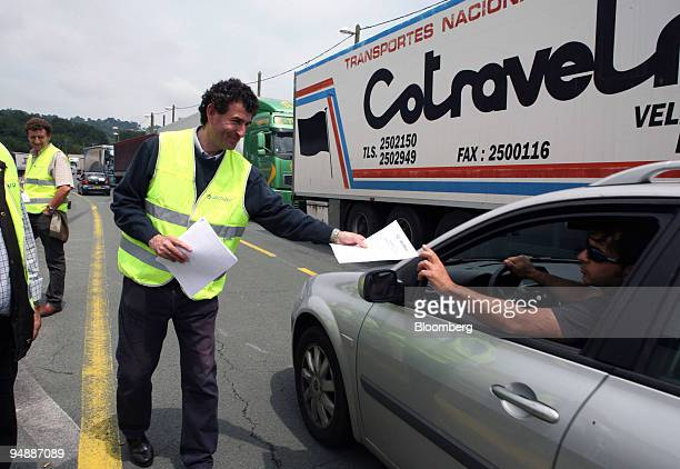 A truck driver hands out leaflets to motorists during a protest about fuel prices near the SpanishFrench border in Irun Spain on Monday June 9 2008...