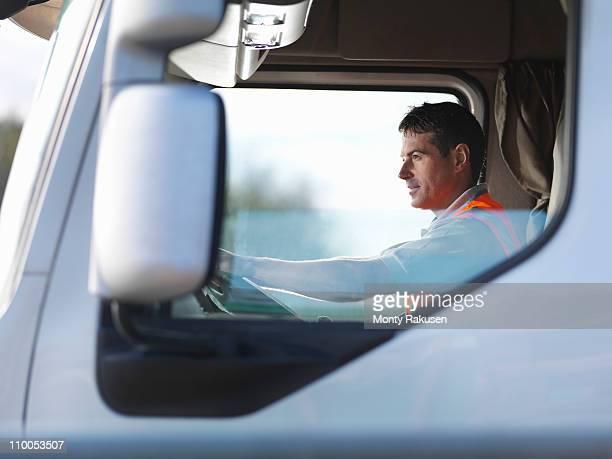Truck driver in truck cab