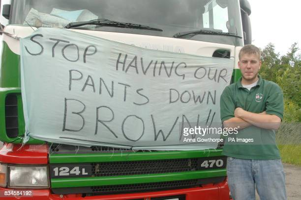 Truck driver Jamie Stalley from Bradford displays a banner on his vehicle as truckers gather near the M62 in West Yorkshire to protest against high...