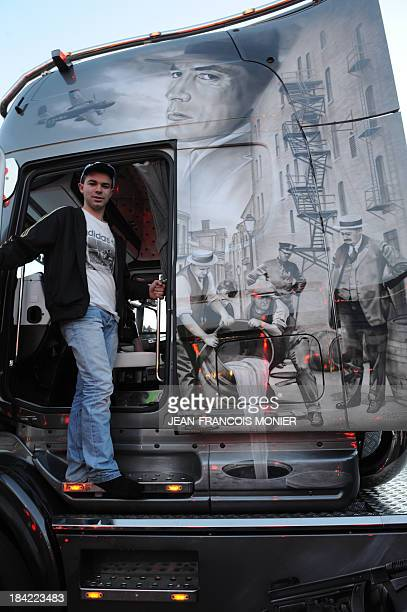 Truck driver Jordan Moule poses in his Scania 580 HP V8 truck decorated with an image inspired by the world of Al Capone on October 12 in Le Mans...