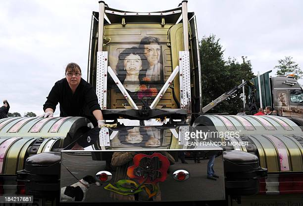 Truck driver Nathalie Cavard cleans her Mercedes 500 HP truck decorated with the images of late French singer Edith Piaf and late French boxer Marcel...