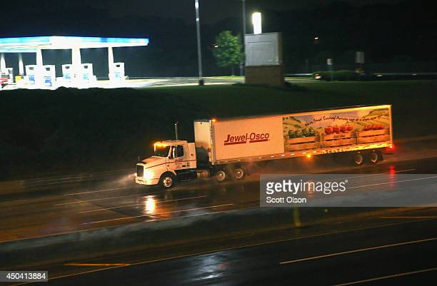 A truck driver navigates a raincovered highway on the outskirts of Chicago on June 10 2014 in Hinsdale Illinois Legislation introduced in the US...