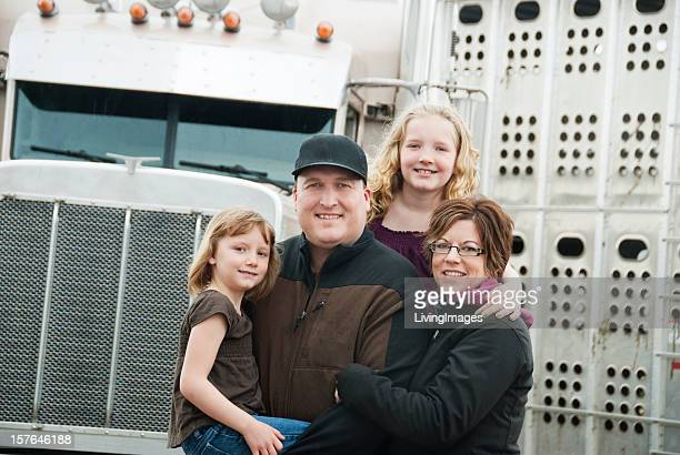 Truck driver posing with two daughters and wife