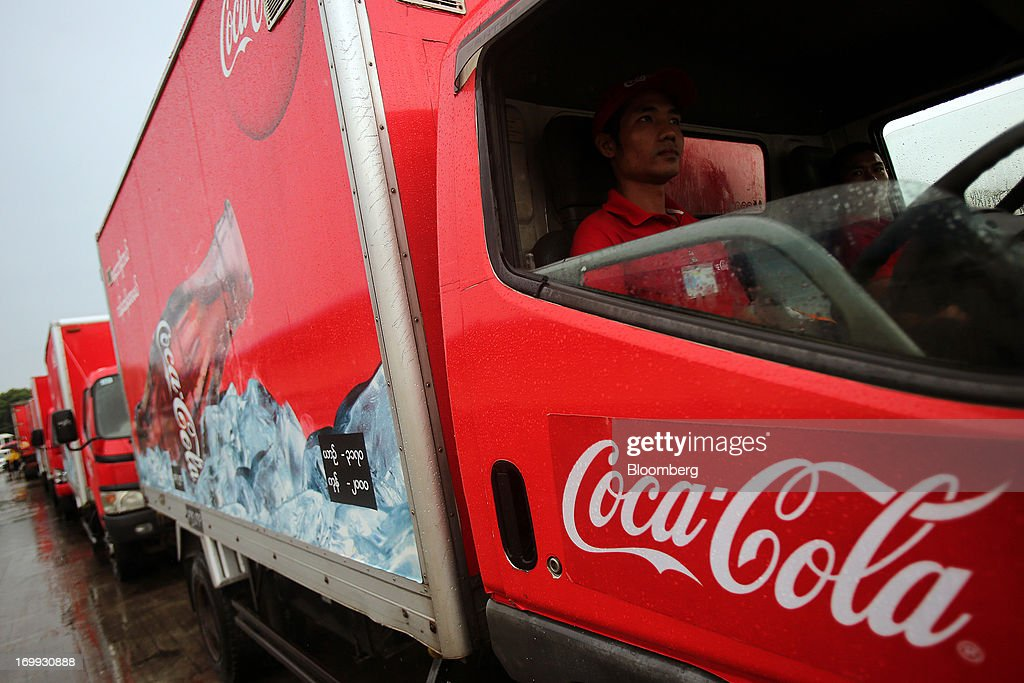 A truck driver sits in a delivery truck outside the Coca-Cola Co. bottling plant in Hmawbi, Myanmar, on Tuesday, June 4, 2013. Coca-Cola Co. Chief Executive Officer Muhtar Kent marked the return of the world's largest soda maker to Myanmar after 60 years by opening a bottling plant and pledging more investment in the newly opened economy. Photographer: Dario Pignatelli/Bloomberg via Getty Images